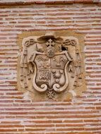 Coat of arms icon on a wall