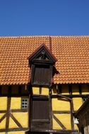 old yellow timber framed house