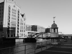 black and white photo of buildings by the river in hamburg