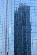 mirror facade of a skyscraper in Hong Kong