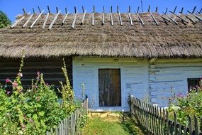 House under a thatched roof in an open-air museum, sanok