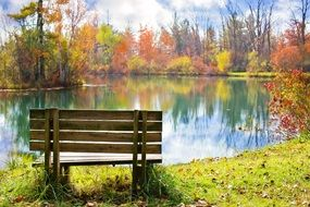 wooden bench near pond autumn fall season