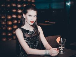 photo of model in an evening dress in the bar