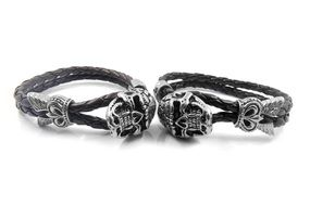 two bracelets with images of skulls