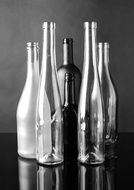 black and white still life with empty bottles