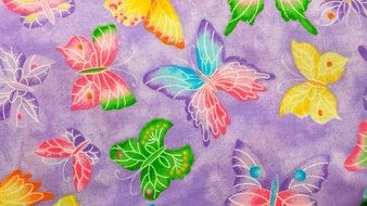 purple fabric with colorful butterflies