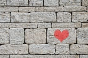 stone wall with red heart