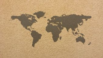 world map on a dark beige texture