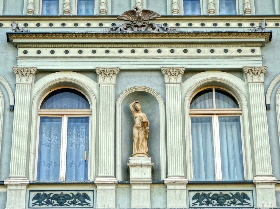 statue as a decoration of a building on the old market square in Bydgoszcz