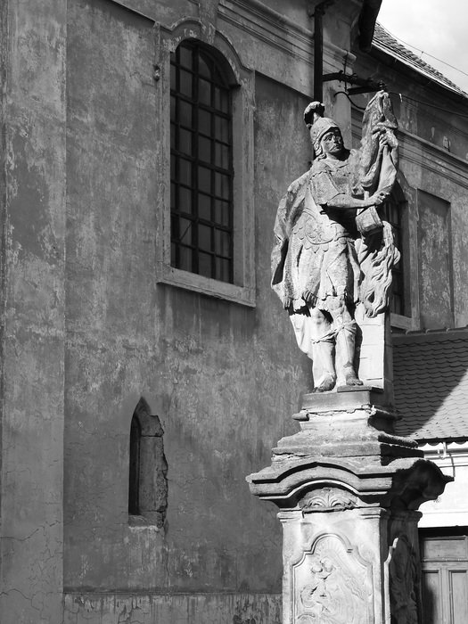 black and white image of a knight statue