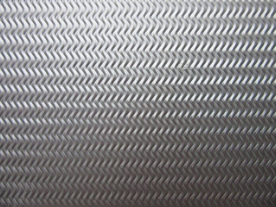 sheet rip shiny metal embossed grey color background