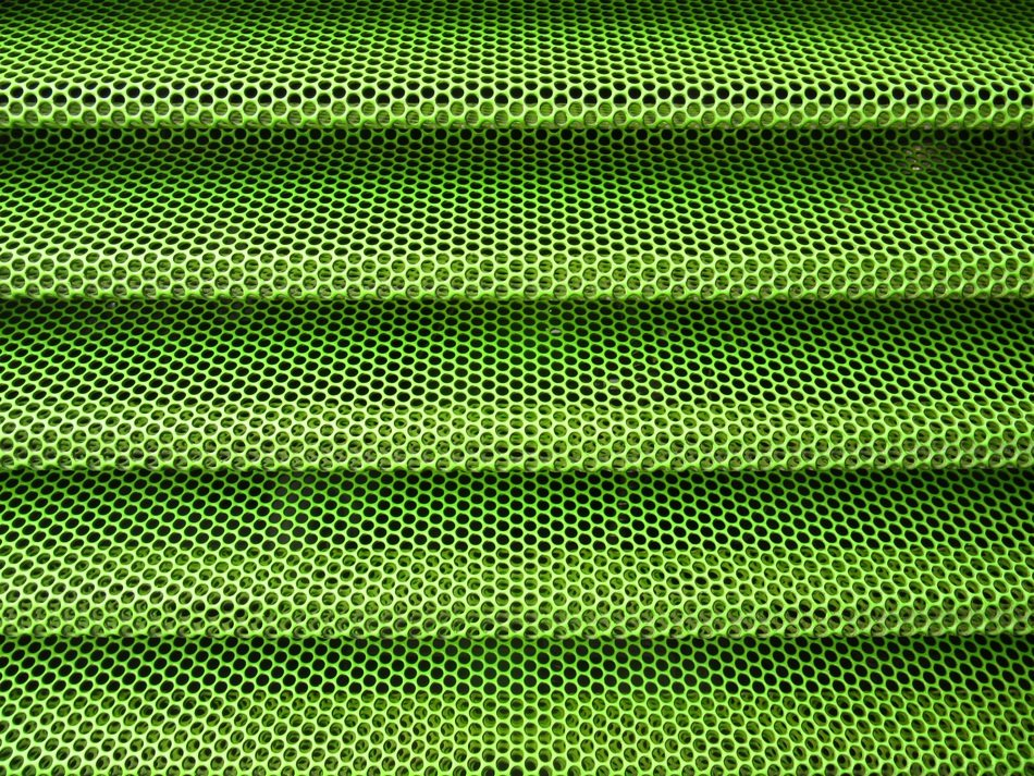 perforated sheet green color holes background