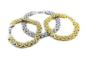 three white and yellow gold bracelets