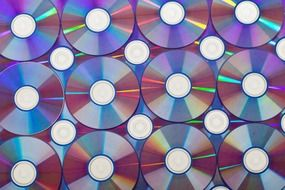 background with repeating compact disks