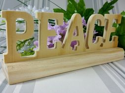 wooden peace decoration with flowers