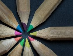 wooden colored crayons in a circle