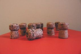 champagne corks on a red table