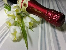 champagne bottle and a romantic bouquet of tulips