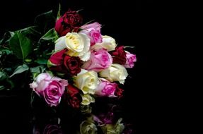 roses bouquet on a black background