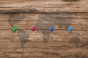 wood board structure map of the world colorful needles