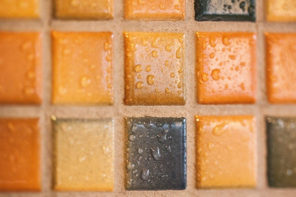 mosaic tiles wall tiling orange shades of brown grey blue