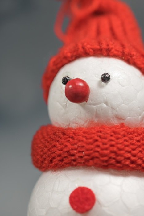 snow winter man in red cap and scarf