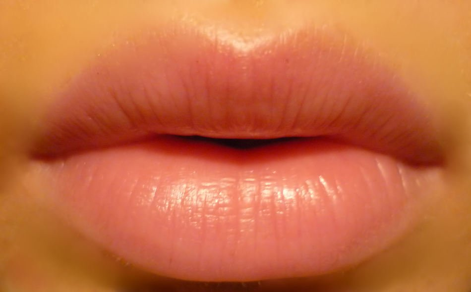lips of a girl with pink lipstick