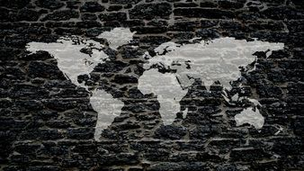 gray map of the world on a black background