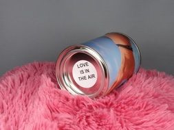 metal container on a pink carpet