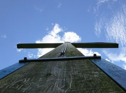 bottom view on wooden cross against the sky