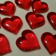 red glass hearts on a white background