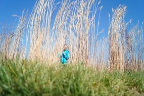woman and huge dried grass