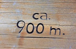carved number on the wooden surface