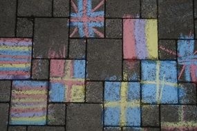 children's chalk drawings on the ground