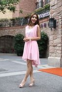 Asian fashion model in a pink dress