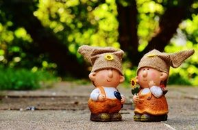 a pair of cute figurines for decorating garden