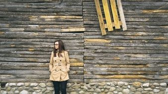girl on the background of an old wooden building