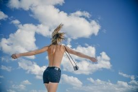 girl young woman back slim sky clouds