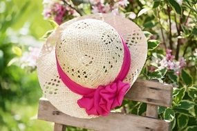straw hat with a pink ribbon