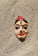 indian woman statue face in sand