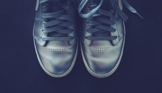 gray sneakers on a black background