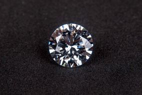 shiny diamond on a black table