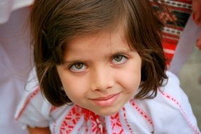 eyes of child dressed in the traditional costume of a peasant woman
