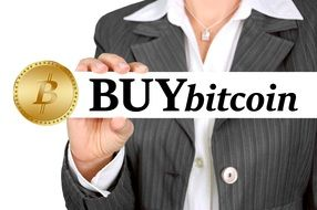 girl with bitcoin sign in hand