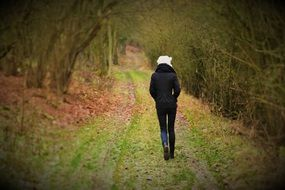 young woman on the forest path