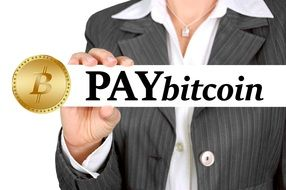 a woman with a sign in his hands paybitcoin