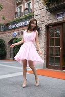 Asian girl in a pink dress
