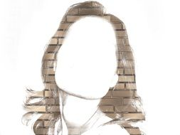 drawing of a female face on a brick wall