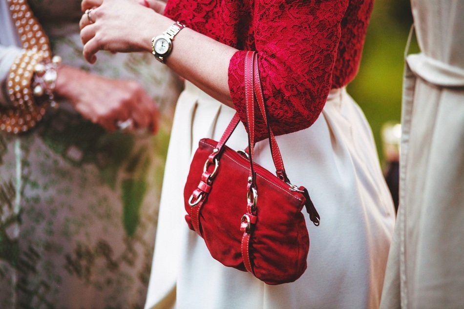 elegant woman with a red handbag