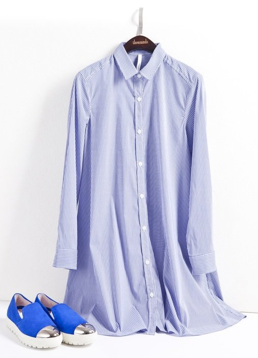 light women's shirt and blue shoes